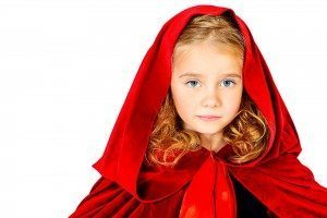 Beautiful little girl in a red raincoat with a hood. Little Red