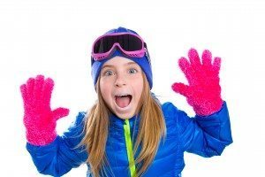 blond kid girl winter snow portrait with open hands pink gloves