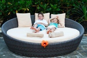 Kids at luxury resort relaxing at beach cabana